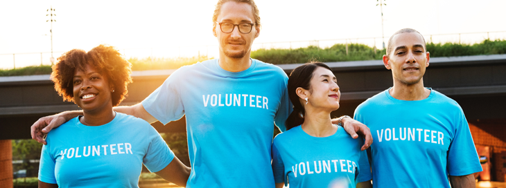 Volunteers in corporate branded clothing
